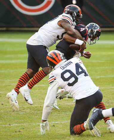 Chicago Bears defensive end Mario Edwards (97) sacks Houston Texans quarterback Deshaun Watson (4) during the second half of an NFL football game at Soldier Field Sunday, Dec. 13, 2020, in Chicago. Photo: Brett Coomer/Staff Photographer / © 2020 Houston Chronicle