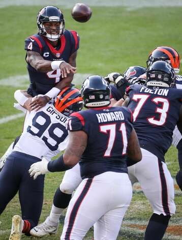 Houston Texans quarterback Deshaun Watson (4) gets rid of the ball as he is hit by Chicago Bears linebacker Trevis Gipson (99) during the second half of an NFL football game at Soldier Field Sunday, Dec. 13, 2020, in Chicago. Photo: Brett Coomer/Staff Photographer / © 2020 Houston Chronicle