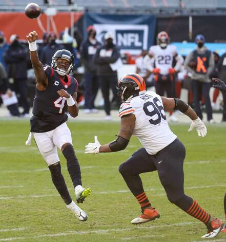 Houston Texans quarterback Deshaun Watson (4) gets rid of the ball over Chicago Bears defensive end Akiem Hicks (96) during the second half of an NFL football game at Soldier Field Sunday, Dec. 13, 2020, in Chicago. Photo: Brett Coomer/Staff Photographer / © 2020 Houston Chronicle