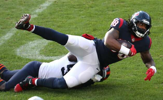 Houston Texans tight end Jordan Akins (88) is brought down by Chicago Bears inside linebacker Roquan Smith (58) during the second half of an NFL football game at Soldier Field Sunday, Dec. 13, 2020, in Chicago. Photo: Brett Coomer/Staff Photographer / © 2020 Houston Chronicle