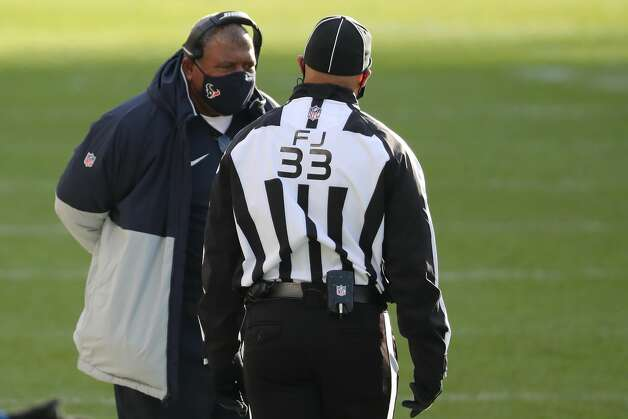 Houston Texans interim head coach Romeo Crennel talks to field judge Steve Zimmer (33) as a play is reviewed during the second half of an NFL football game at Soldier Field Sunday, Dec. 13, 2020, in Chicago. Photo: Brett Coomer/Staff Photographer / © 2020 Houston Chronicle