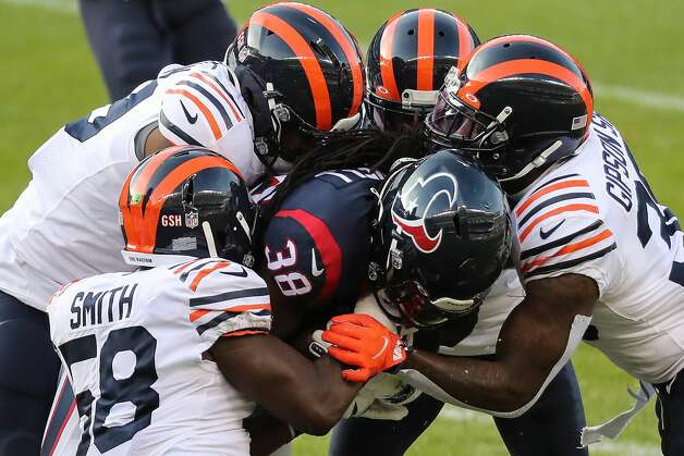 Houston Texans running back Buddy Howell (38) is stopped by a host of Chicago Bears defenders during the second half of an NFL football game at Soldier Field Sunday, Dec. 13, 2020, in Chicago. Photo: Brett Coomer/Staff Photographer / © 2020 Houston Chronicle