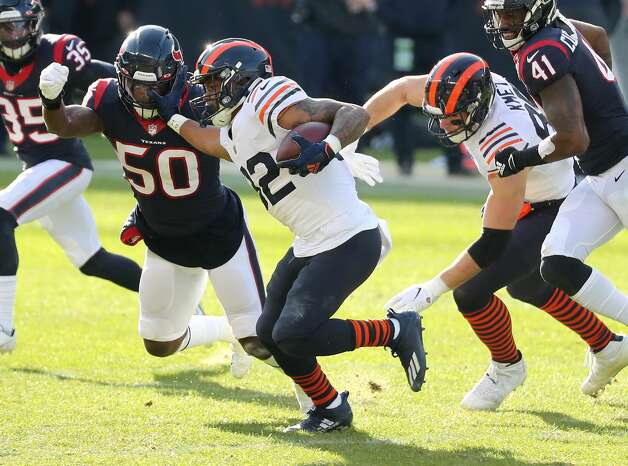 Chicago Bears running back David Montgomery (32) stiff arms Houston Texans outside linebacker Tyrell Adams (50) as he runs the ball during the second quarter of an NFL football game at Soldier Field Sunday, Dec. 13, 2020, in Chicago. Photo: Brett Coomer/Staff Photographer / © 2020 Houston Chronicle