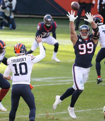 Chicago Bears quarterback Mitchell Trubisky (10) tosses the ball over the outstretched arms of Houston Texans defensive end J.J. Watt (99) during the second quarter of an NFL football game at Soldier Field Sunday, Dec. 13, 2020, in Chicago. Trubisky completed the pass for a 12-yard touchdown. Photo: Brett Coomer/Staff Photographer / © 2020 Houston Chronicle