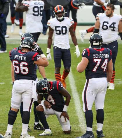 Houston Texans quarterback Deshaun Watson (4) kneels on the field after he was sacked by Chicago Bears defensive end Mario Edwards on the final play of the game during the second half of an NFL football game at Soldier Field Sunday, Dec. 13, 2020, in Chicago. Photo: Brett Coomer/Staff Photographer / © 2020 Houston Chronicle