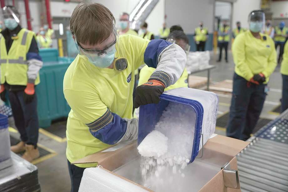 Dry ice is poured into a box containing the Pfizer-BioNTech COVID-19 vaccine as it is prepared Sunday to be shipped at the Pfizer Global Supply manufacturing plant in Portage, Michigan. Photo: Morry Gash | AP / Copyright 2020 The Associated Press. All rights reserved