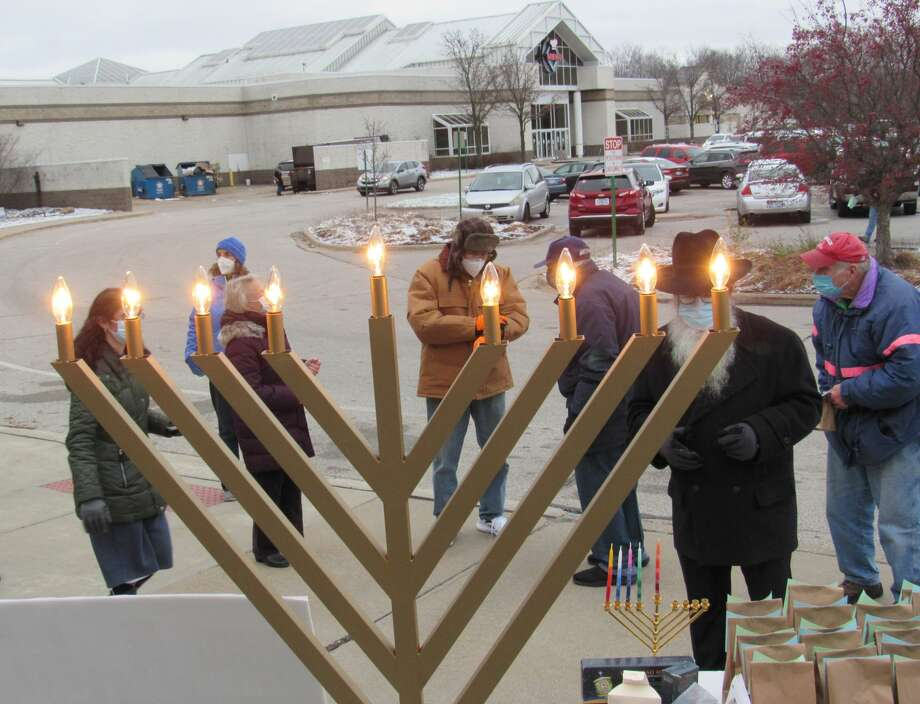 People gather for a Hanukkah celebration, enjoying music and the lighting of the menorah, hosted by Chabad of Eastern Michigan on Dec. 13, 2020, outside of the Midland Mall. (Mitchell Kukulka/Mitchell.Kukulka@mdn.net) Photo: Mitchell Kukulka