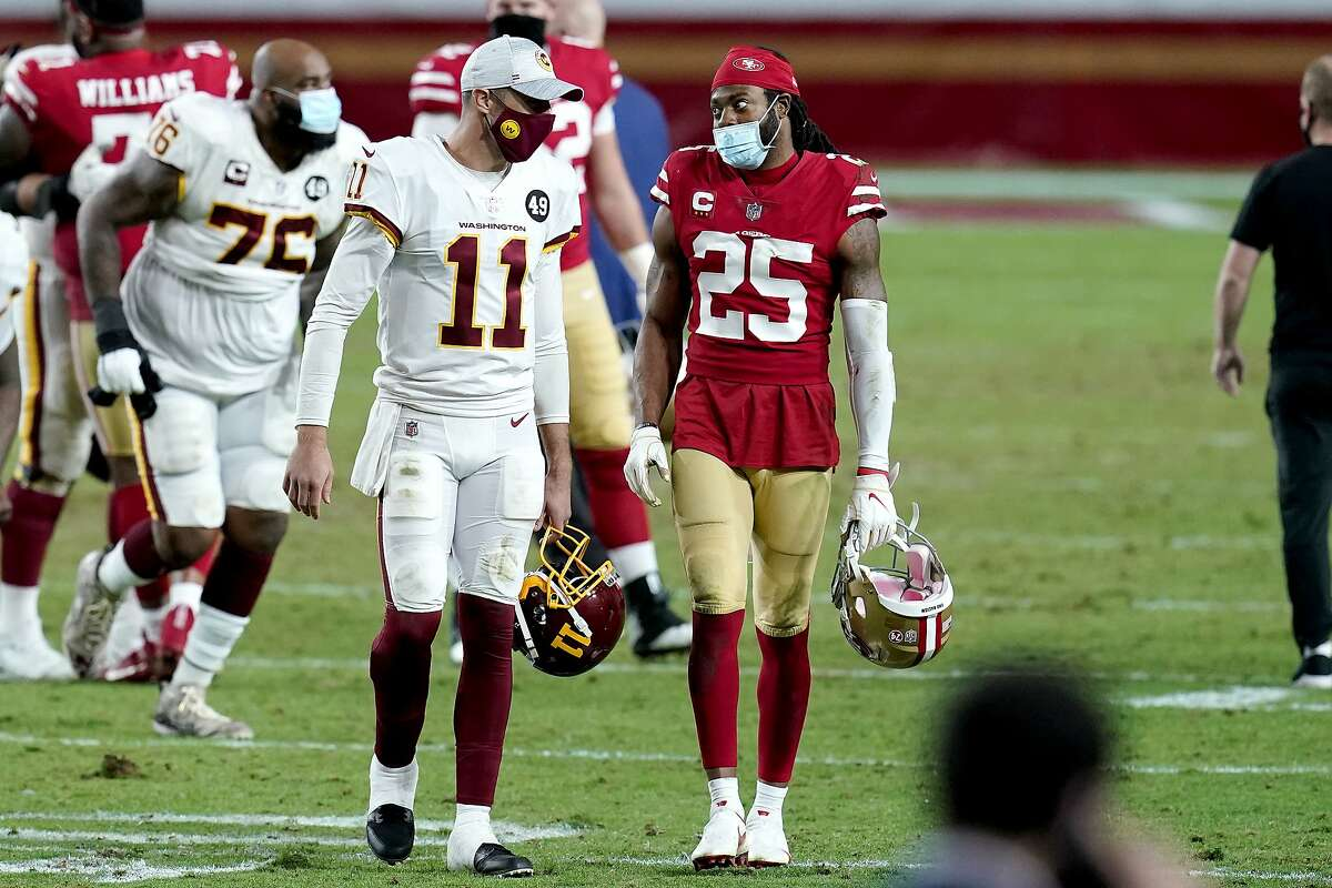 Washington quarterback Alex Smith, who started his NFL career in San Francisco, talks with 49ers' cornerback Richard Sherman after a Dec. 13 game in Glendale, Ariz.