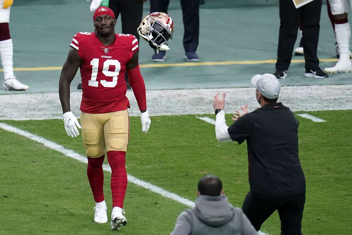 San Francisco 49ers wide receiver Deebo Samuel (19) throws his helmet to a trainer after getting injured during the first half of an NFL football game against the Washington Football Team, Sunday, Dec. 13, 2020, in Glendale, Ariz. (AP Photo/Ross D. Franklin)