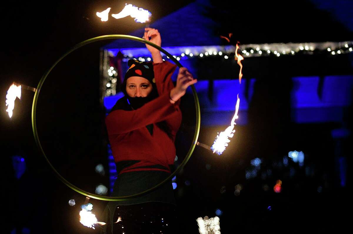 Sarotonin Performance Arts puts on a fire juggling show as Celebrate Shelton holds its seventh annual community tree lighting Friday, December 11, 2020, at the Rotary Pavilion at Veteran's Memorial Park in Shelton, Conn. In addition to the tree lighting and the visit from Santa and Mrs. Claus, the event featured an ice sculpture demonstration by Ice Matters; a fire dance performance with Sarotonin Performance Arts; and a holiday dance party. The community tree lighting was sponsored by the city, Center Stage Theatre, Apple Rehab, Jones Family Farm, Echo Hose Hook & Ladder Co. 1 and Valley Community Foundation.