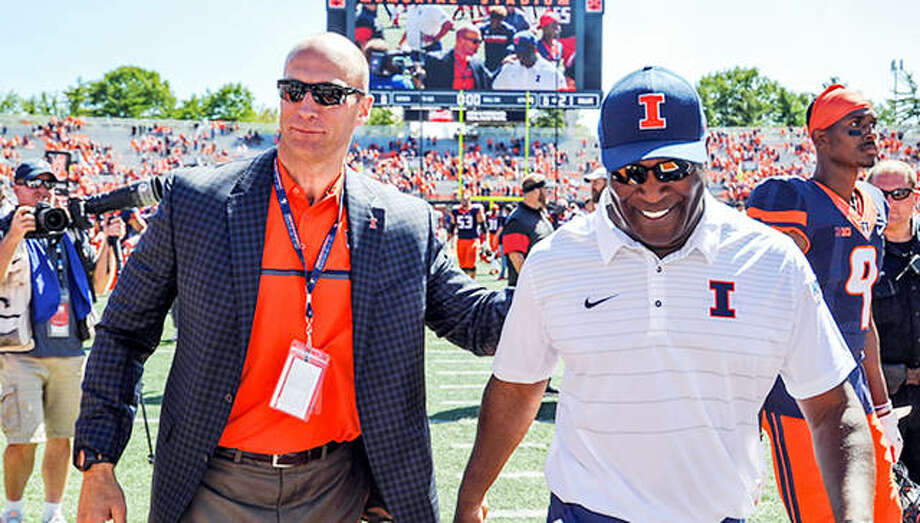 Illinois athletic director Josh Whitman, left, and former head football coach Lovie Smith leave the field following a 2019 game at Memorial Stadium. Smith was fired Sunday after five seasons with the Illini. Photo: Associated Press