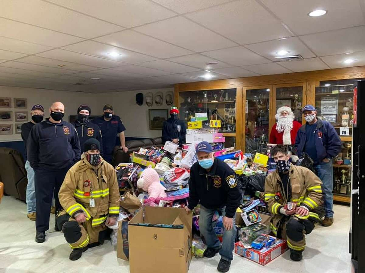 Santa Claus, alongside his firefighting elves, collected dozens of donated toys rode during his ride through the White Hills of Shelton on Saturday.