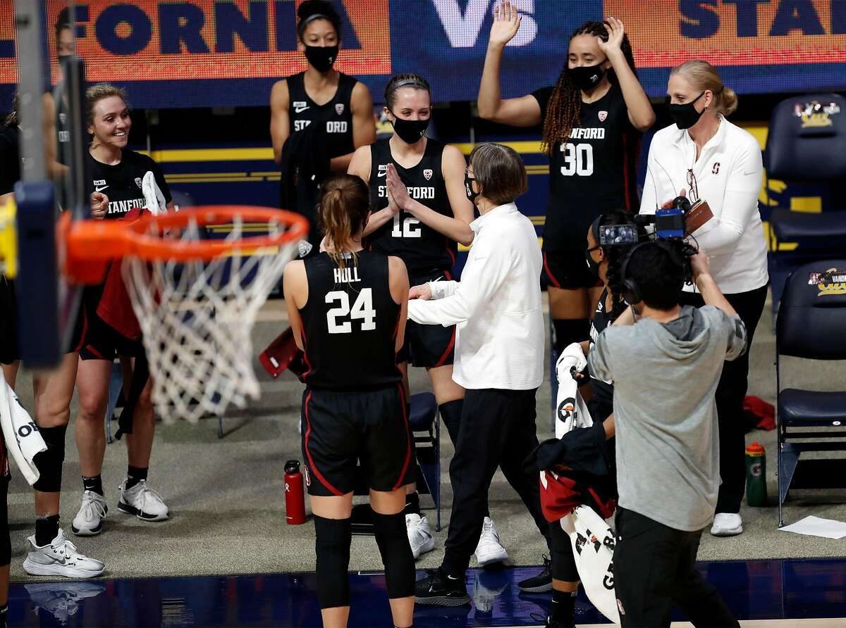 Stanford head coach Tara VanDerveer receives cheers from her team after tying Pat Summitt as the all-time winningest women's college basketball coach.