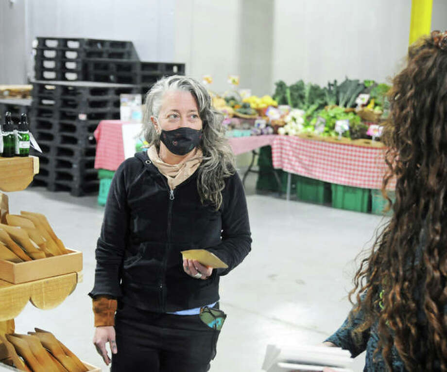 Kirsten Detec, of St. Louis, shops for herbs during Saturday's Holiday Cheers Market at the Old Bakery Beer Co. in Alton. The market returns for a final time this season Saturday, Dec. 19. Photo: David Blanchette|For The Telegraph