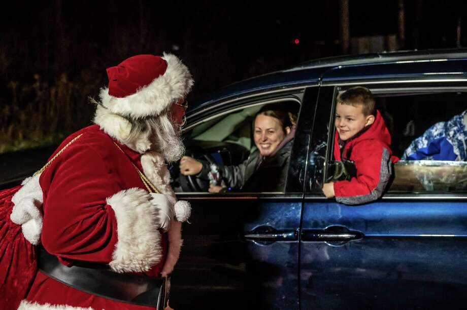 Participants decorated their vehicles for the Stay in Your Sleigh holiday car parade, hosted by the Bullock Creek/Pine River PTO, Friday, Dec. 11, 2020 at Bullock Creek Elementary School. (Adam Ferman/for the Daily News)