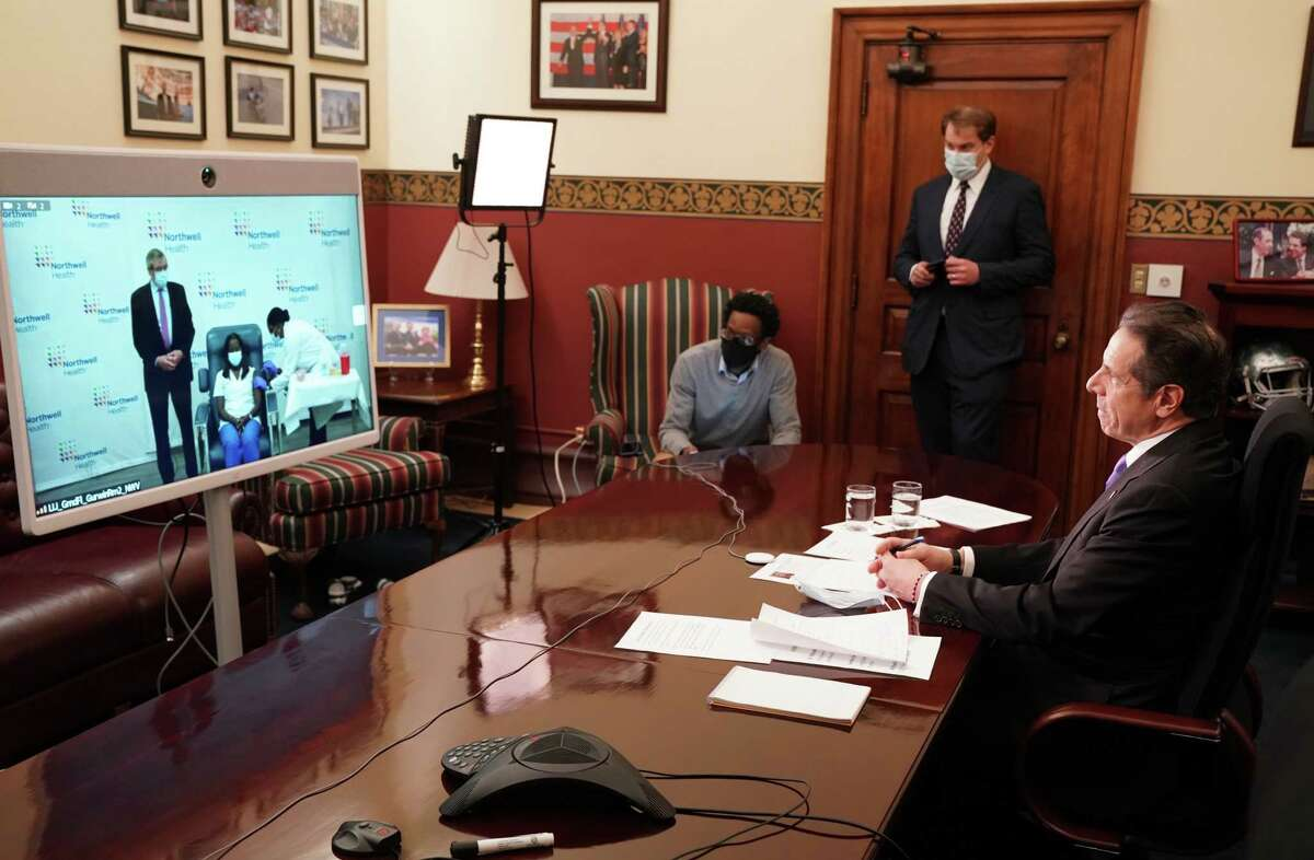 Gov. Andrew Cuomo observes the state's first COVID-19 inoculation on Monday, Dec. 14, 2020, at the Capitol in Albany, N.Y. (Office of the Governor)