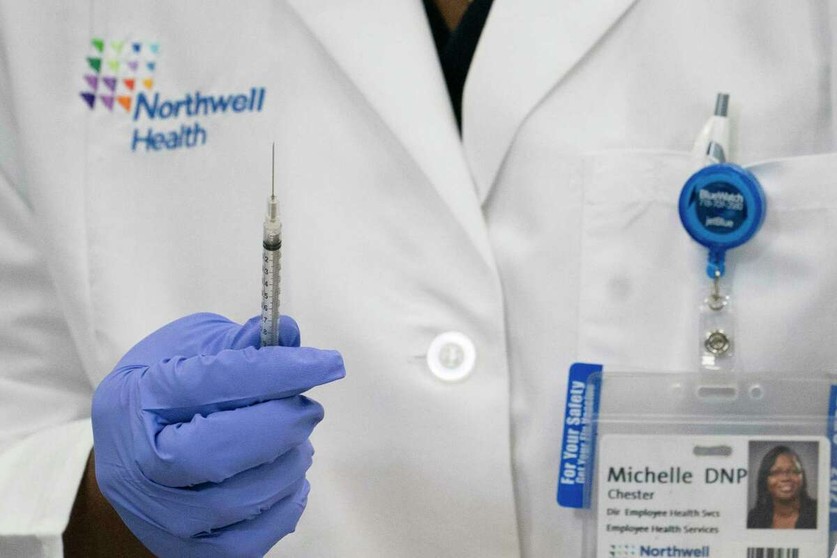 FILE. Letter writer says public-facing workers should get next vaccine priority. (Mark Lennihan/AP)