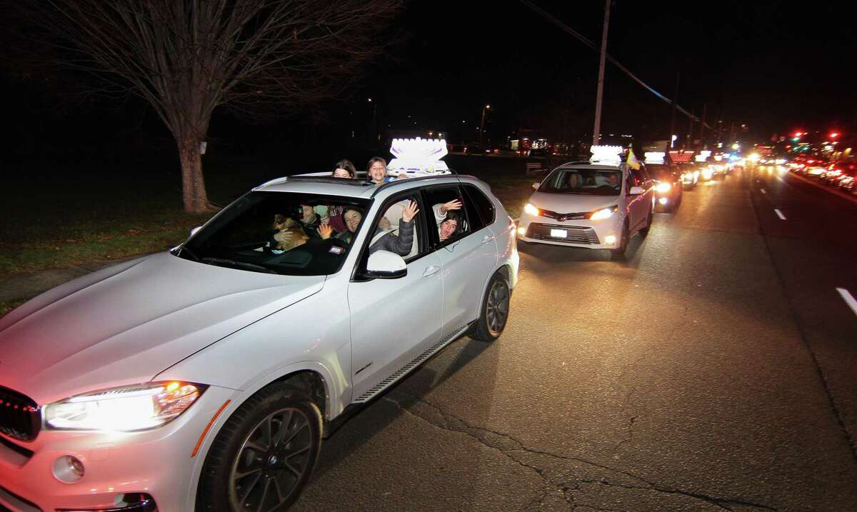 Members of Chabad of Fairfield hold a Car Menorah Parade along Post Road in Fairfield, Conn., on Thursday Dec. 10, 2020. A Menorah lighting to celebrate Hanukkah came at the end of the parade that started at Chabad of Fairfield, joined Chabad of Shelton and Chabad of Westport members midway along the route along Post Road in Fairfield.