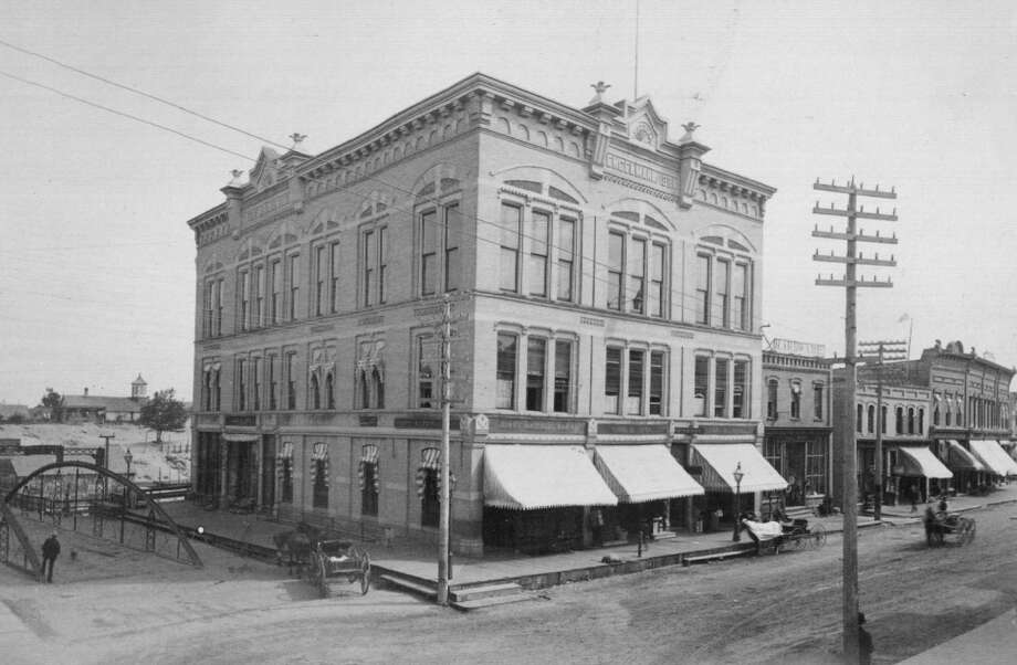 """The first Engelmann Block was formerly located on the corner of River and Maple streets. In the """"Nell Evans"""" serial, it is noted that the character of Frank Randolph took an office in the Engelmann Block. The building was once home to several businesses which included various law, dentists, and doctors offices on the second floor. The building was destroyed by fire in May, 1909 and was replaced by the second Engelmann Block which continues to stand on the same corner. Photo: Manistee County Historical Museum Photo"""