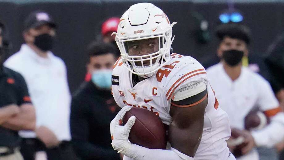 Texas' Joseph Ossai carries during an NCAA college football game against Oklahoma State, in Stillwater, Okla., Saturday, Oct. 31, 2020. (AP Photo/Sue Ogrocki) Photo: Sue Ogrocki, STF / Associated Press / Copyright 2020 The Associated Press. All rights reserved.
