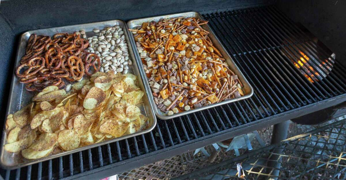 Snack foods such as pretzels, pistachio nuts, potato chips and Smoked Sweet and Spicy Chex Party Mix smoke at 225 degrees with oak wood.