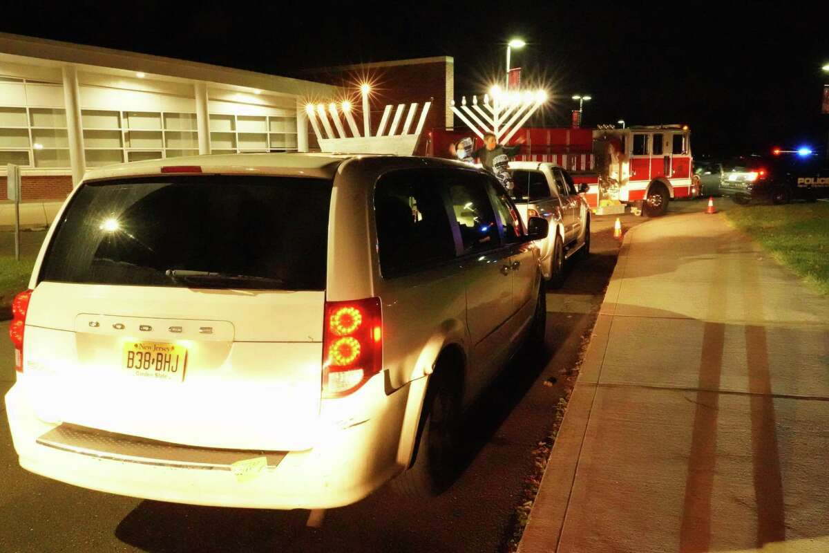 The Hanukkah parade, led by the New Canaan Fire Department, traveled to God's Acre from Saxe Middle School around 6 p.m.. Sunday, Dec. 13.