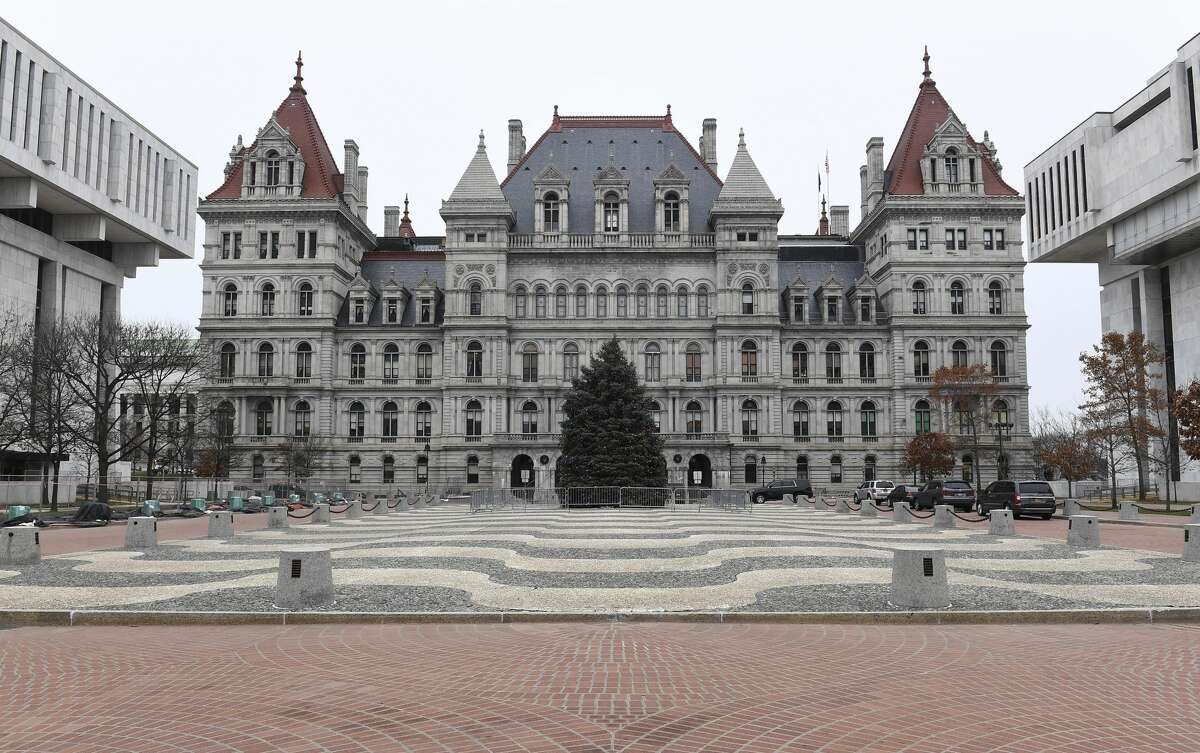 Albany Police closed State Street, which separates the state Capitol and the Empire State Plaza a day after two people were stabbed during a protest. (AP Photo/Hans Pennink)