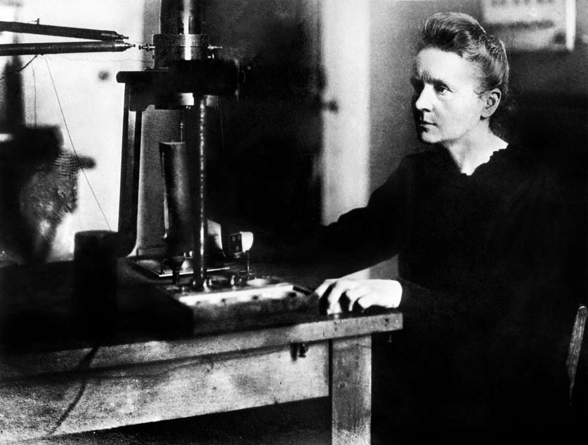 (FILES) In this file picture dated 1925 Professor Marie Curie works in the laboratory of Paris university. - Marie Curie and her husband, the French physicist Pierre Curie were the discoverers of radium and won the Nobel prize for physics in 1903. Pierre Curie was born in Paris 15 May 1859 and his most important contributions to physics was the discovery that the magnetic properties of substances change at certain temperature, known as the