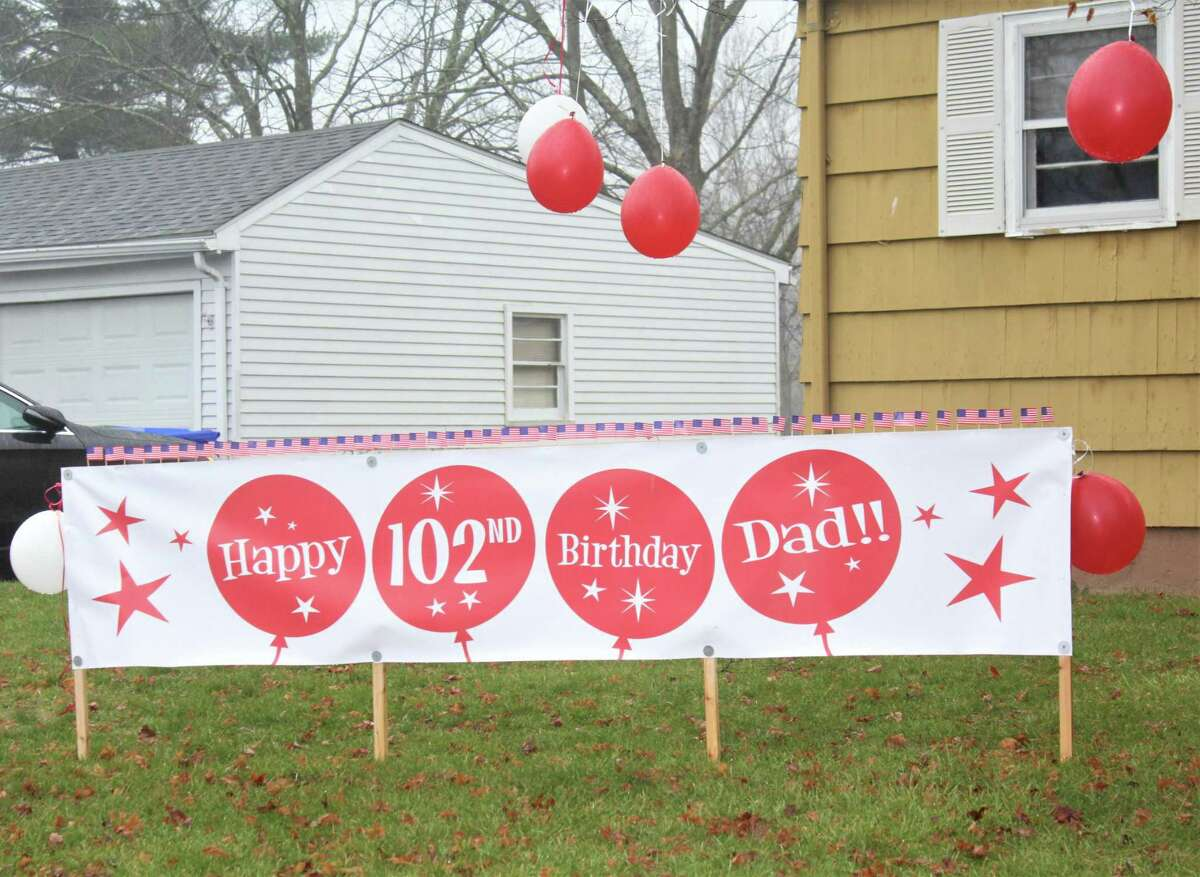 Former longtime Middletown firefighter John E. Cyrulik Sr. was surprised Saturday afternoon by a fire truck and police brigade to mark his 102nd birthday. His lawn was decorated by family members for the occasion.