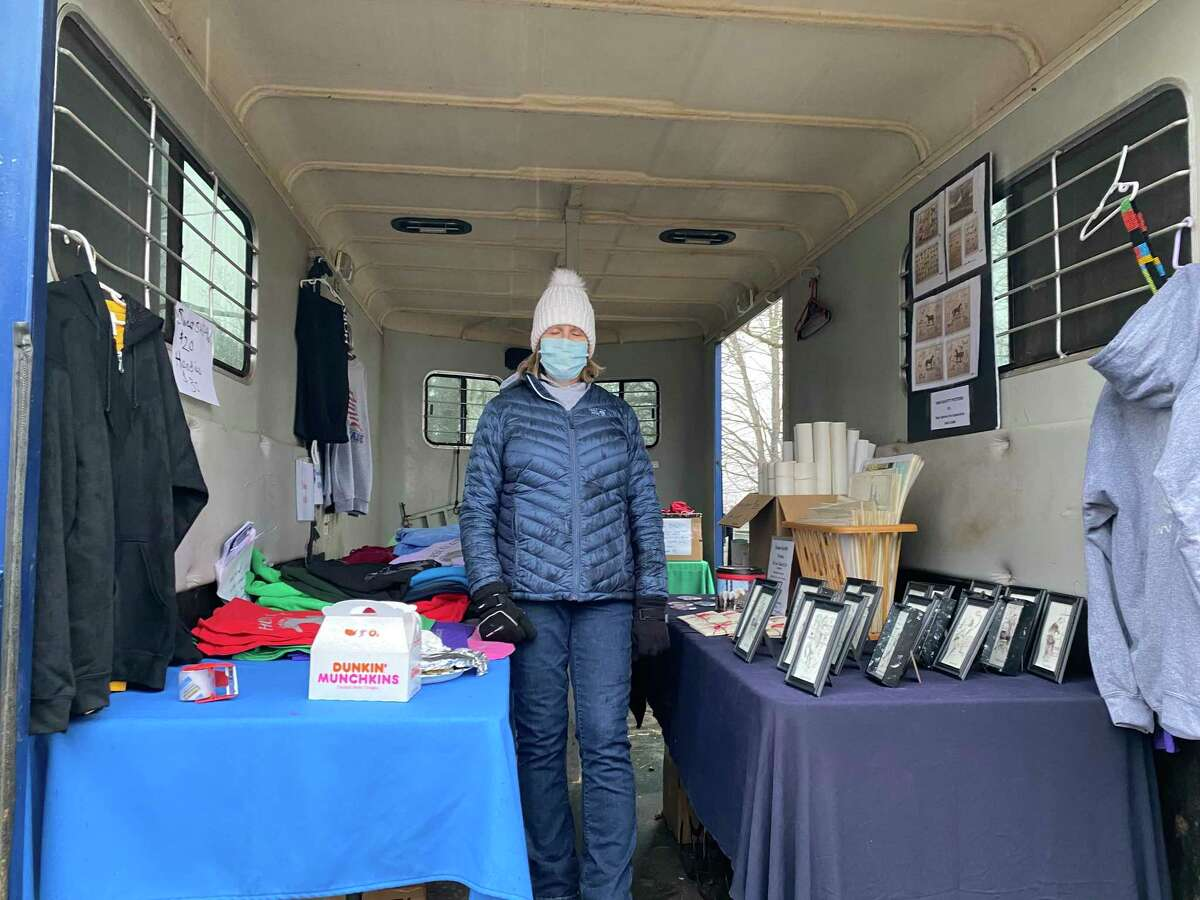 One of the volunteers selling items at fundraiser for H.O.R.S.E. of Connecticut in Washington on Saturday, Dec. 12.