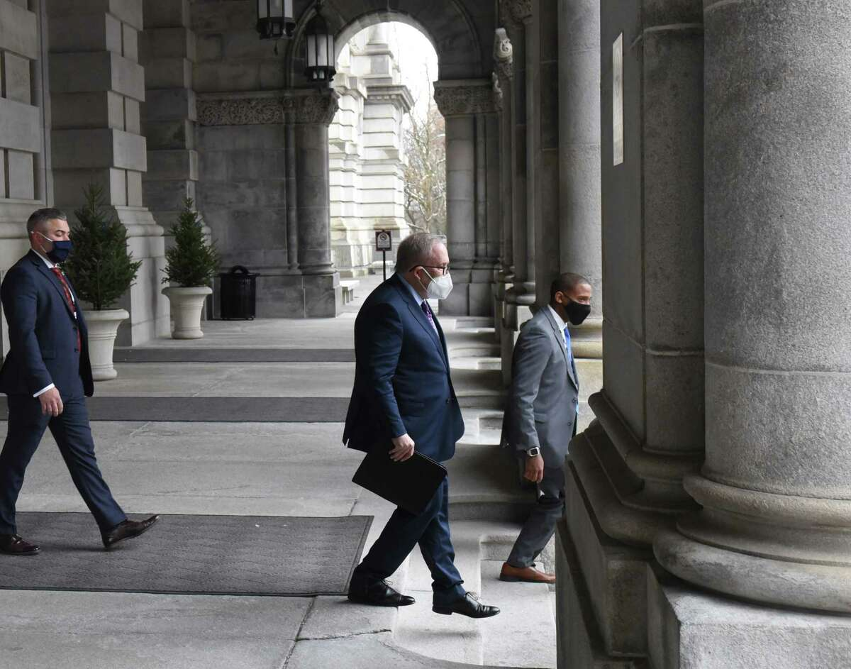 New York City Comptroller Scott Stringer, center, was among those seen leaving the Capitol after taking part in the New York Electoral College vote on Monday, Dec. 14, 2020, in Albany, N.Y. (Will Waldron/Times Union)