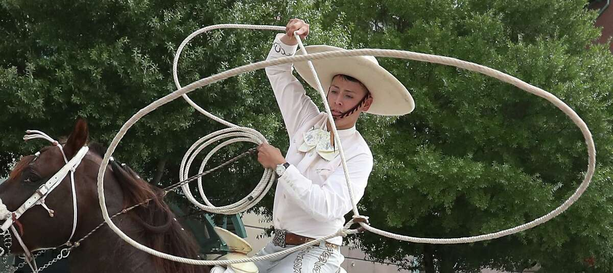 A vaquero performs a roping demostration along the parade route during the 50th Annual Houston Fiestas Patrias Parade Saturday, Sept. 15, 2018, in Houston.