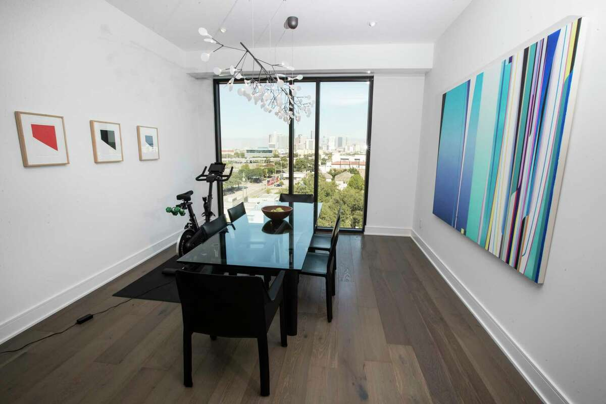 The dining room has a trio of pieces by Ellsworth Kelly, left, and a large-format abstract painting by Dion Johnson, right.