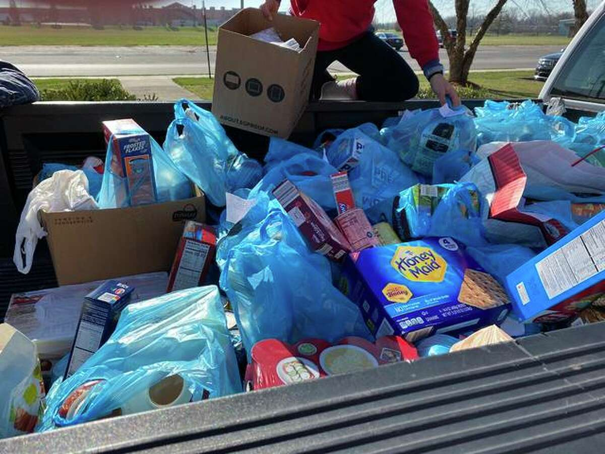 Volunteers deliver a truck full of food items to Glen-Ed Pantry during a recent holiday food drive.