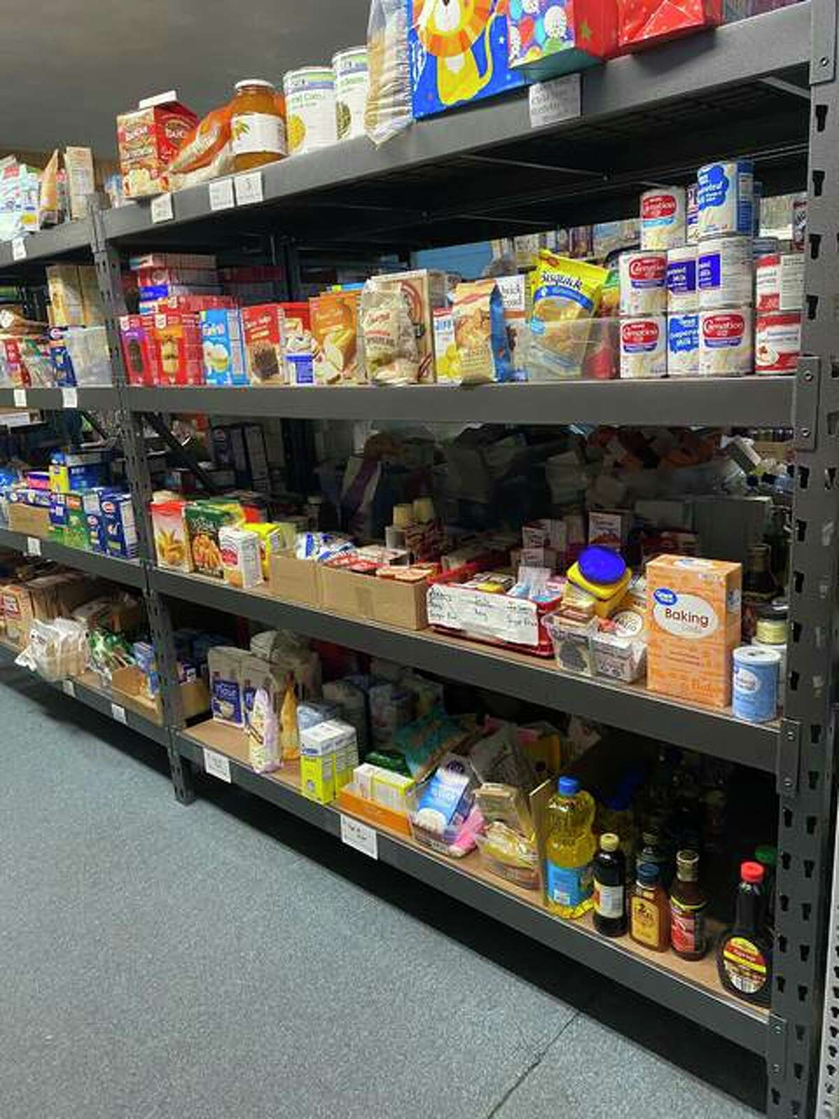 The shelves at Glen-Ed Pantry are currently full of food and other items, but Jane Ahasay, director of development for the the pantry, wants to make sure the shelves will remain full beyond the holidays.