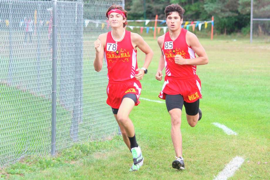 Manistee Catholic Central seniors Henry Hybza (left) and Mateo Barnett (right) were named all-conference in the West Michigan D League this season while running for Mason County Eastern in a co-op. MCC's Peter Hybza was also named all-conference. (News Advocate file photo)
