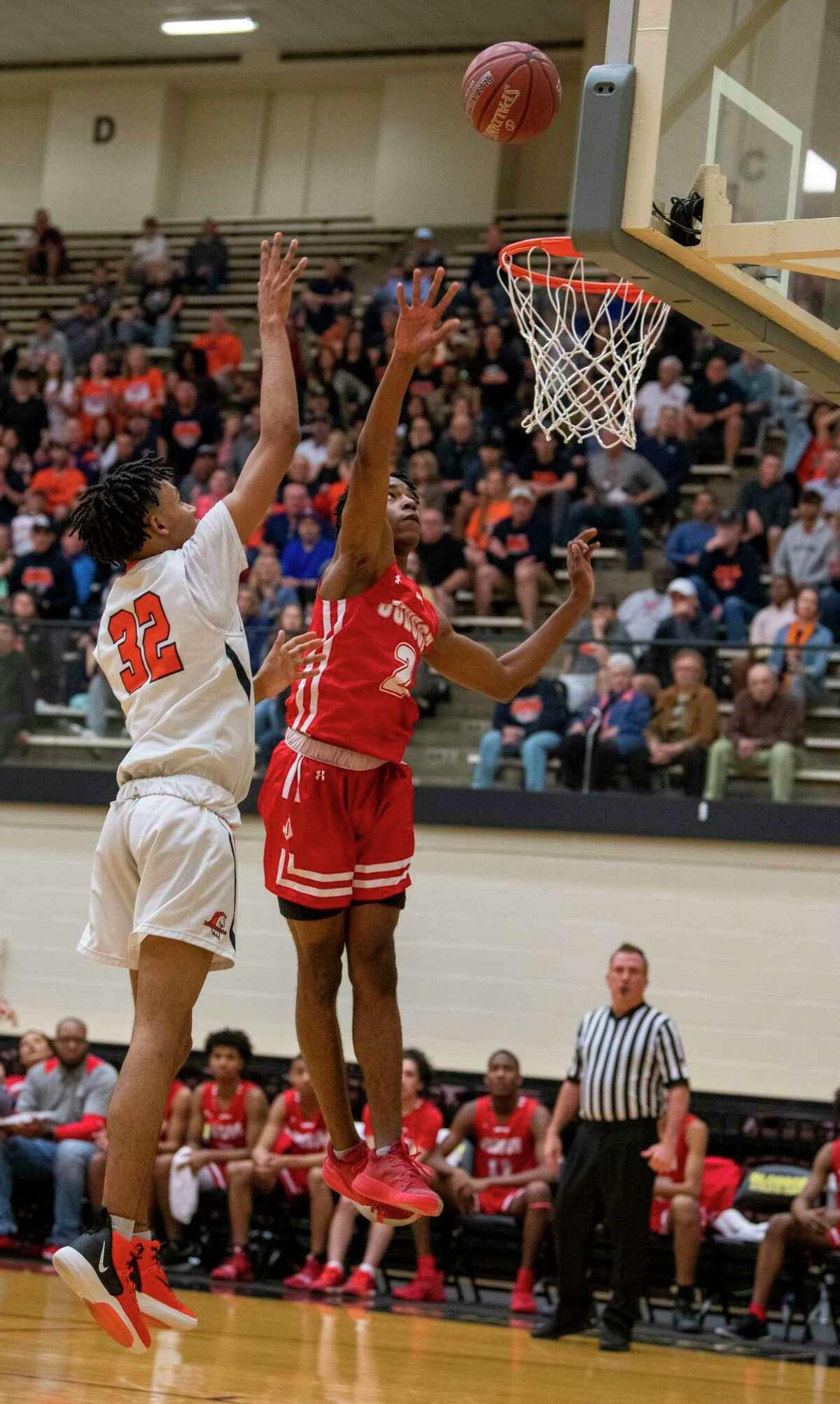 Brandies Bronco Kyle Schaefer tries to score against Judson Rockets Anariss Brandon during the first half of a High School Basketball Class 6A Regional Final on Saturday, March 7, 2020. Brandies beat Judson 68-75.