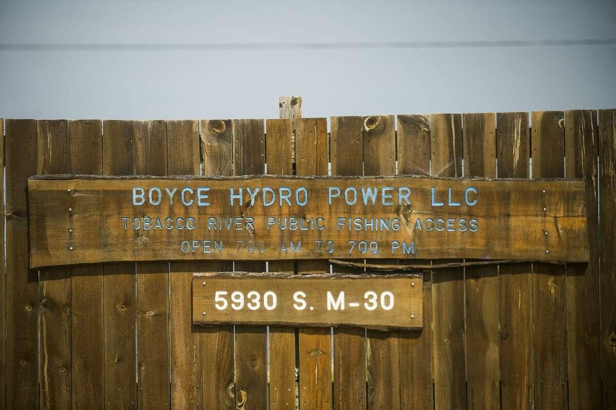 Boyce Hydro signs are posted near the Edenville Dam September 22, 2020. (Katy Kildee/kkildee@mdn.net)