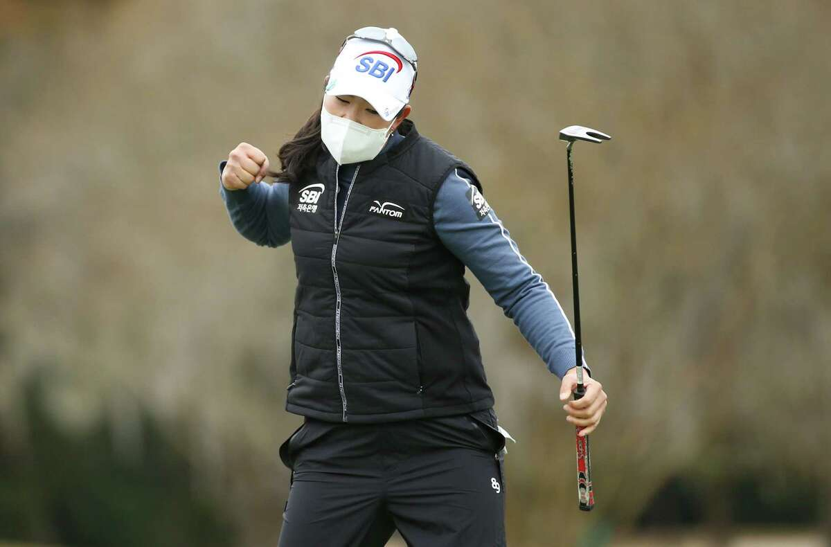 A Lim Kim of Korea reacts as she sinks a putt on the 18th hole to finish the day at three below parr and eventually winning the 75th Annual U.S. Women's Open at Champions Golf Club in Houston on Monday, Dec. 14, 2020.
