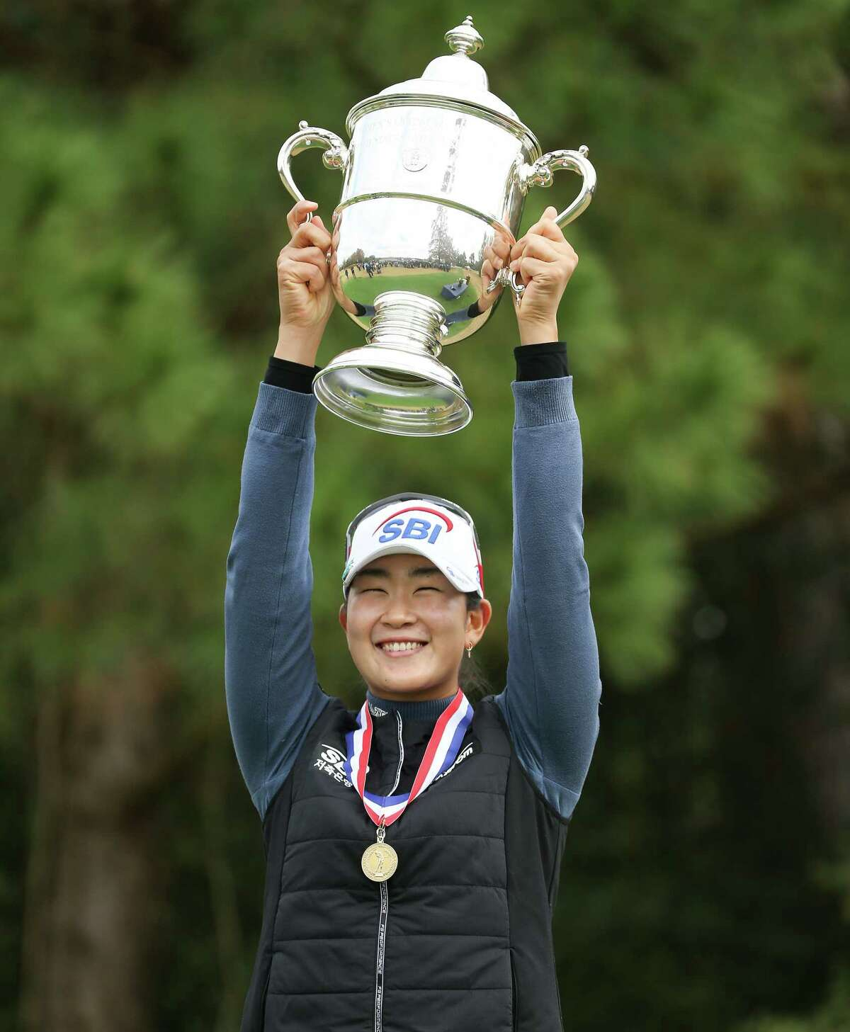 A Lim Kim of Korea holds up the Harton S. Semple trophy after winning the 75th Annual U.S. Women's Open at Champions Golf Club in Houston on Monday, Dec. 14, 2020.