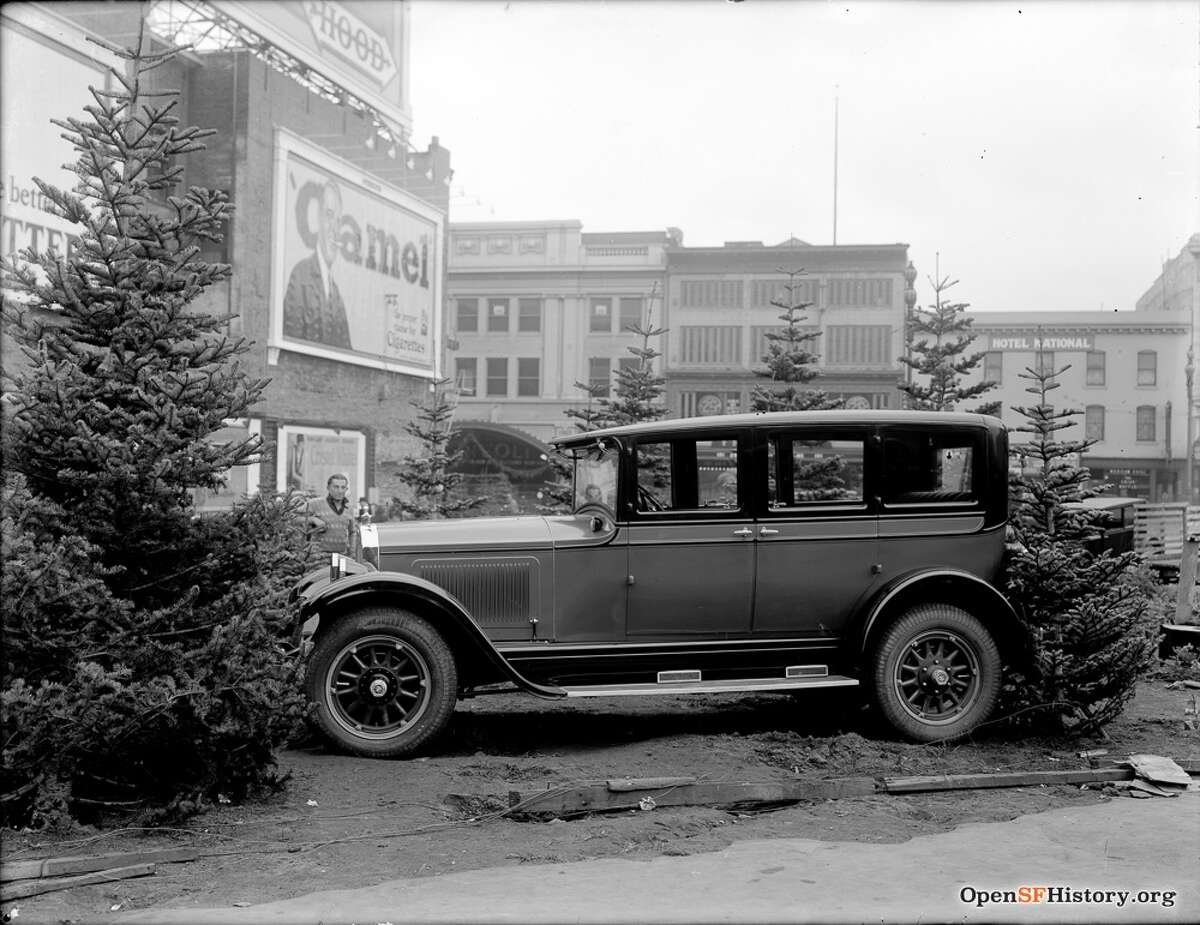 A Christmas tree and auto lot on the current site of U.N. Plaza on Market Street in 1925.
