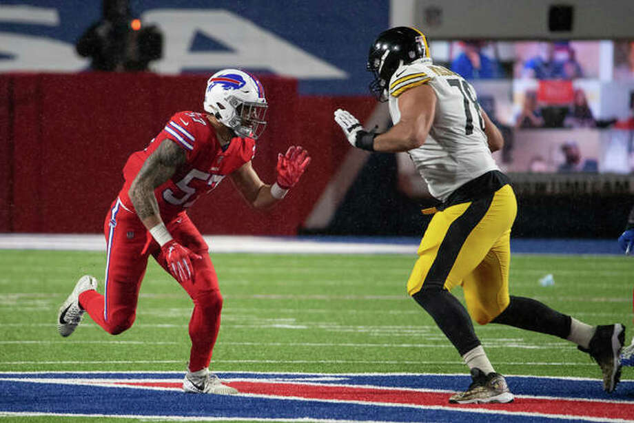 Buffalo Bills defensive end A.J. Epenesa (57) pass rushes against Pittsburgh Steelers offensive tackle Alejandro Villanueva (78) during an NFL football game, Sunday, Dec. 13, 2020, in Orchard Park, N.Y.