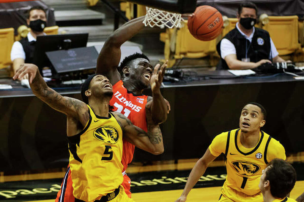 Missouri's Mitchell Smith, left, and Illinois' Kofi Cockburn, center, collide while Xavier Pinson, right, during the first half of an NCAA college basketball game Saturday, Dec. 12, 2020, in Columbia, Mo.