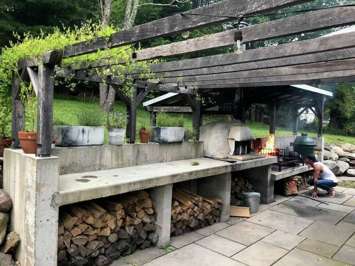 This renovated 1889 Airbnb property in the Catskills features an outdoor kitchen with a wood-fired pizza oven, a Big Green Egg smoker, and a Uruguayan grill - as wonderful in winter as in the summer months.