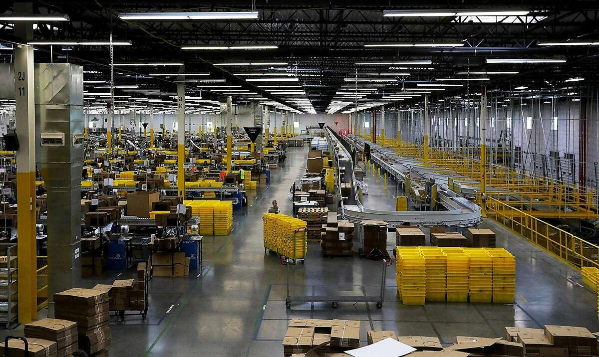 Amazon has centers like this one in Kent, Wash., throughout California, and the state wants data about how the firm handles the coronavirus in them.