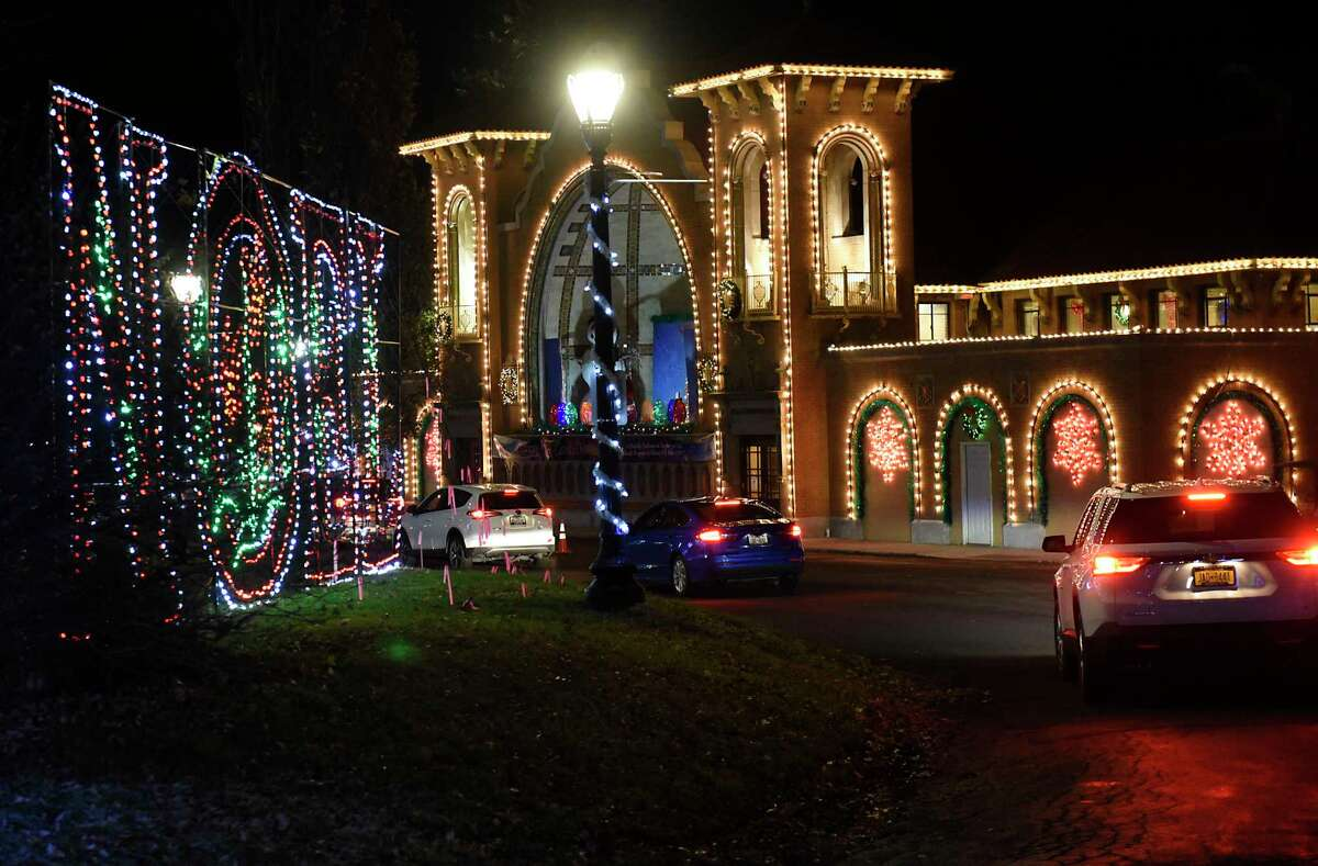 Cars are seen driving slowly past displays at the Capital Holiday Lights in Washington Park on Thursday, Dec. 10, 2020 in Albany, N.Y. (Lori Van Buren/Times Union)