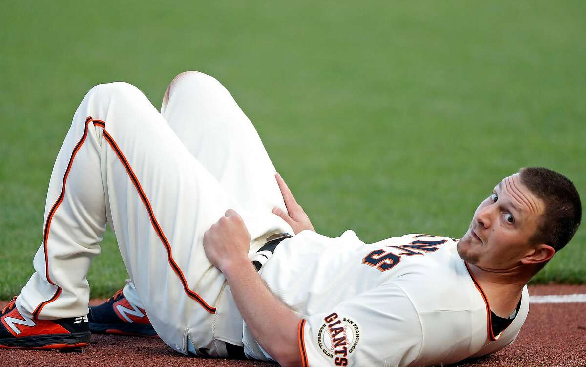 San Francisco Giants' Alex Dickerson smiles after avoiding a foul ball hit by Hunter Pence in 2nd inning against San Diego Padres during MLB game at Oracle Park in San Francisco, Calif., on Wednesday, July 29, 2020.