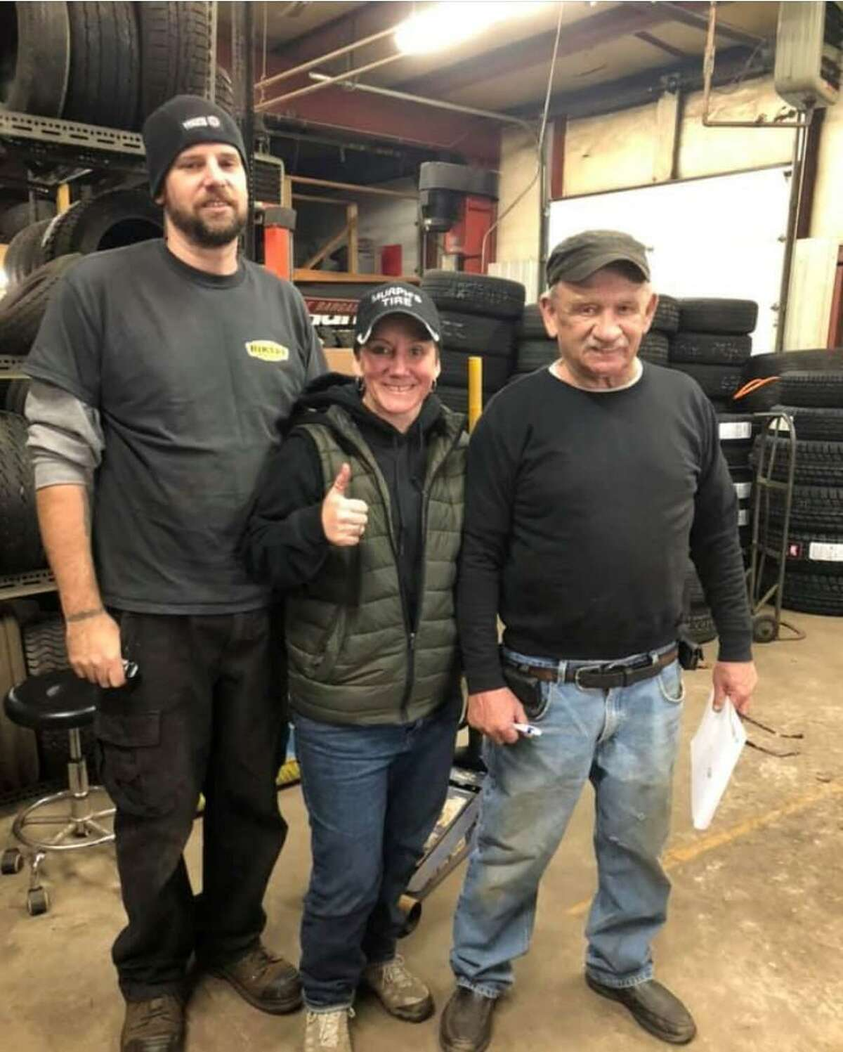 Gary Murphy, right, founder of Murphy's Tire Shop in New Milford, is shown with his daughter Beth and her husband, Jeff Taylor, the new owners of the business located at 11 Howland Road.