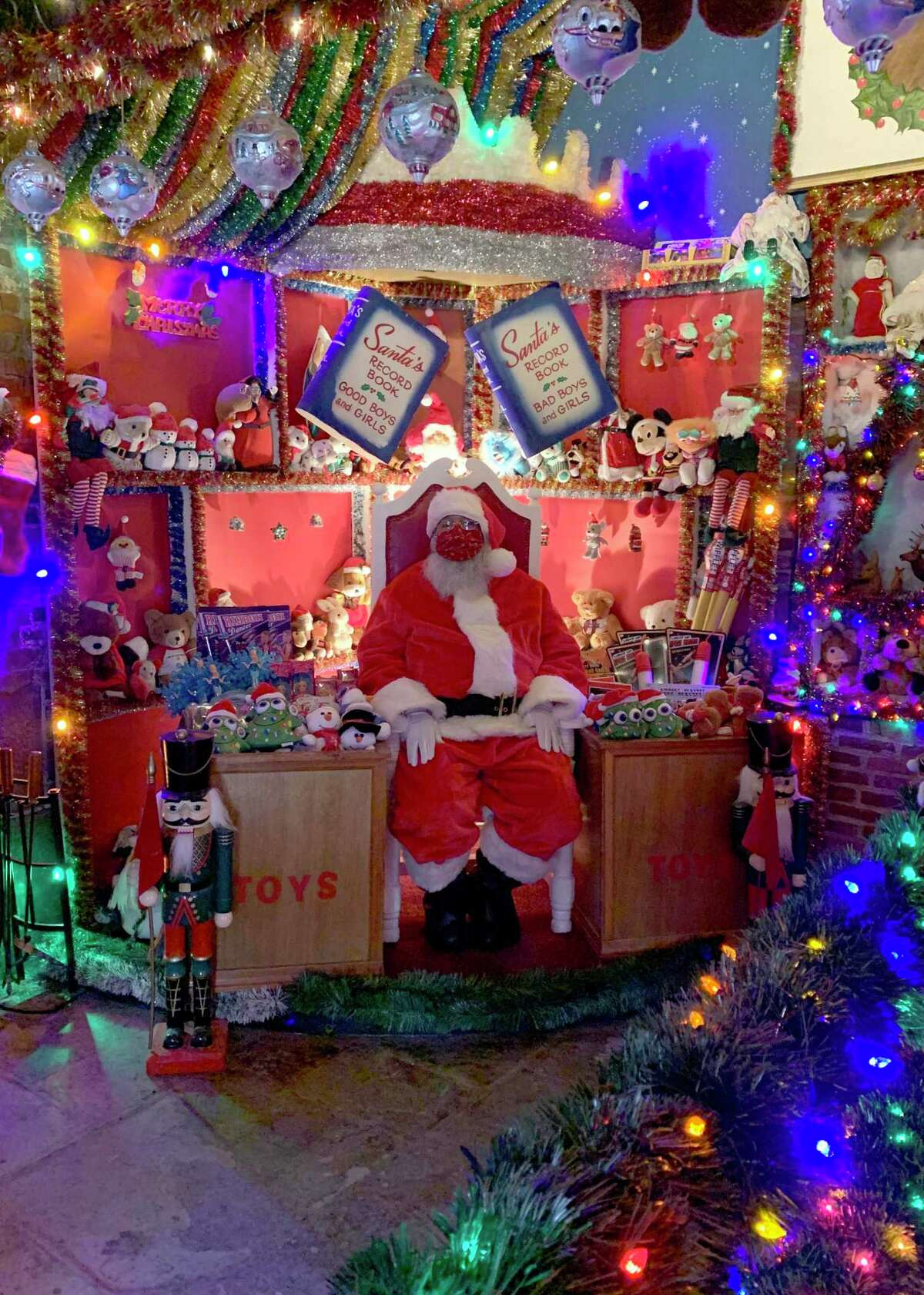 Torrington's Christmas Village opened Sunday and is open daily until Christmas Eve. Because of the COVID-19 pandemic, all visitors had to make advance reservations. Above, Santa Claus waits for visitors in his special toy room at the village.