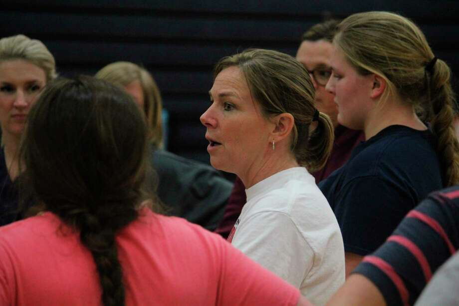 Big Rapids athletic director Dawn Thompson (center), also softball coach, talks with her team last March after what would be its final practice before the season suspension because of COVID. (Pioneer file photo)
